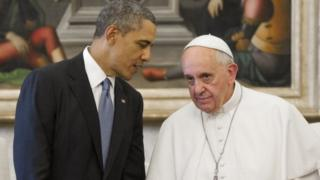President Obama speaks with Pope Francis during a meeting in Rome on 27 march, 2014.