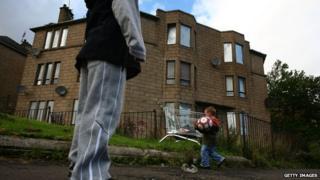 Boys play in a rundown Glasgow street