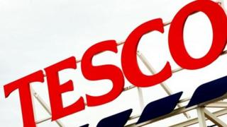 a general view of a Tesco supermarket sign