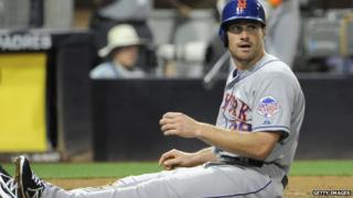 Daniel Murphy sits on the infield dirt during a baseball game on 15 August, 2013.