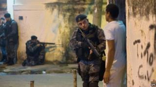 Heavily-armed police patrol a shanty town in Rio de Janeiro, on March 13, 2014