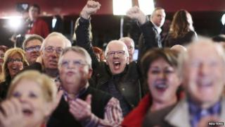 People cheer at the Quebec Liberal leader Philippe Couillard's provincial election rally headquarters in St. Felicien, Quebec, 7 April 2014