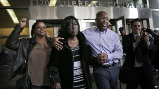Jonathan Fleming, second from right, exits the courthouse with his mother Patricia Fleming, second from right, in New York, 8 April 2014