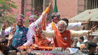 In this photograph taken on April 9, 2014, Narendra Modi (C) in Vadodara to file his nomination papers