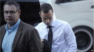 South African track star Oscar Pistorius arrives for his trial at the North Gauteng High Court in Pretoria on 11 April
