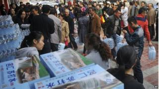 People line up to buy bottled water in Lanzhou on Friday 11 April