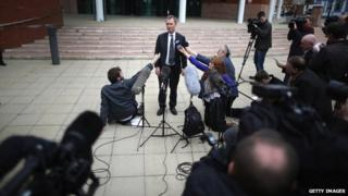 Nigel Evans surrounded by the press outside court