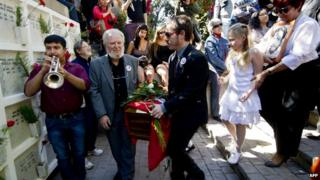 Relatives of Chilean journalist Carlos Berger carry his remains during a ceremony on April 13, 2014.