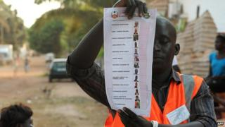 Guinea-Bissau voter holds up ballot paper
