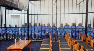 The 23 defendants in court on Monday