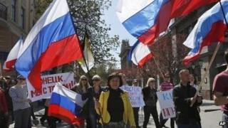 Demonstrators carry Russian flags in support of pro-Russian protesters in eastern Ukraine, in Simferopol, Crimea