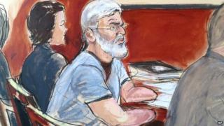 In this courtroom drawing, Mustafa Kamel Mustafa , centre, is flanked by his defense team, attorney Julie Howe left and Joshua Dratel, right in New York 14 April 2014