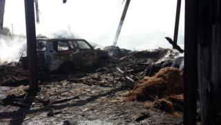 One 50m by 35m barn, containing 50 tonnes of hay and a Toyota Land Cruiser, was completely gutted.
