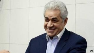 Hamdeen Sabahi has his hand print scanned as he registers his candidacy for president on 3 April