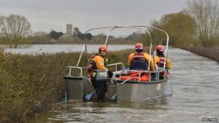 Boat operated by emergency services heading toward Muchelney