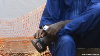 An Ebola survivor sitting down
