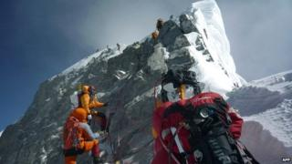Mountaineers approach the Hillary Step while pushing for the summit of Mount Everest - 19 May 2009