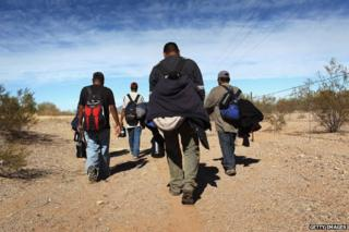 Undocumented Mexican immigrants walk through the Sonoran Desert after illegally crossing the US-Mexico border in 2011