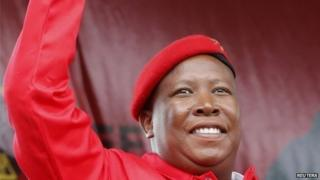 Julius Malema greets Economic Freedom Fighters (EFF) supporters at the launch of its election manifesto in Tembisa township, east of Johannesburg on 22 February 2014