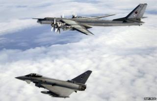 A QRA Typhoon F2 escorts a Russian Bear-H aircraft over the North Atlantic Ocean after a previous incursion in 2008