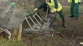 Workers recovering abandoned trolleys