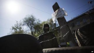 A man behind a barricade outside local government buildings in Horlivka