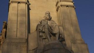 The statue of Miguel de Cervantes, one of Spain's most important literary figures, is seen next to the statue of one of his most famous characters, Don Quixote, from his famous novel at the monument in his honour at Plaza de Espana square in central Madrid March 7, 2014.