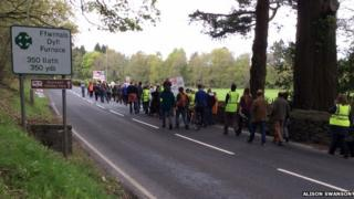 Villagers from Glandyfi, Eglwysfach and Furnace march about pavements