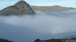 Tryfan peak appearing from cloud, with Brocken image captured