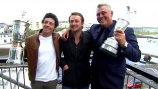 Rory McIlroy, Graeme McDowell and Darren Clarke with their trophies