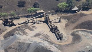This March 12, 2014 photo shows a confiscated iron ore mining operation near the Pacific port of Lazaro Cardenas
