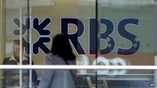 A customer walks into a branch of the Royal Bank of Scotland building