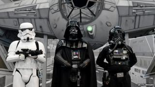 Fans dressed as Darth Vader and imperial soldiers gather at a convention in Germany on 28 July, 2013.