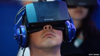 A man wears an Oculus Rift virtual reality headset at a electronics trade show in January 2014.