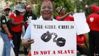 A woman at a demonstration calling on the government to increase efforts to rescue the 276 missing kidnapped school girls of a government secondary school Chibok, in Lagos