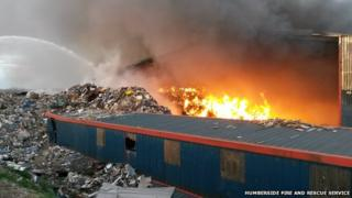 Fire burning at a waste recycling plant