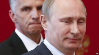 Russia's Putin and Swiss President Didier Burkhalter in Moscow on 7 May 2014
