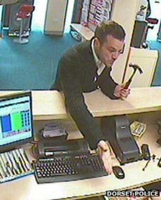 CCTV image of man with hammer
