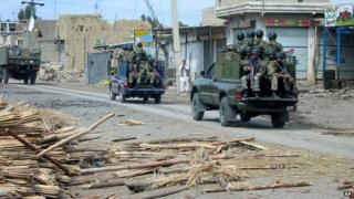 Troops of Pakistan army patrol in a militant area of Miramshah in North Waziristan, in 2006.