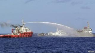 A Chinese ship (left) uses water cannon on a Vietnamese Sea Guard ship on the South China Sea on 3 May 2014