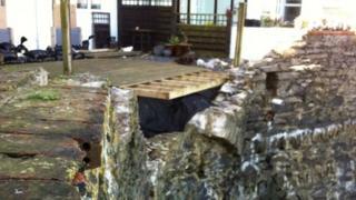 Damaged sea wall