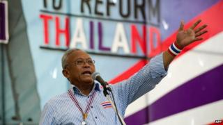 Anti-government protest leader Suthep Thaugsuban delivers a speech during a rally at Government House in Bangkok on 11 May 2014