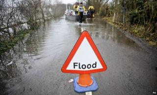 A flood warning sign in the village of Muchelney, Somerset, after it was cut off by flooding in January 2014