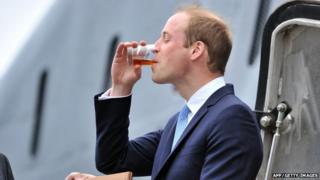 Prince William visiting HMS Alliance at the Royal Navy Submarine Museum in Gosport and drinking rum