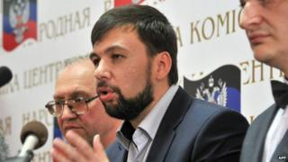 "Denis Pushilin (C), the self-styled governor of the so-called ""People""s Republic of Donetsk"" speaks as Roman Lyagin (R), Chairman of the Central Election Commission and Boris Litvinov, coordinator of the Central Election Commission (L) listen during a press conference in Donetsk on May 12"