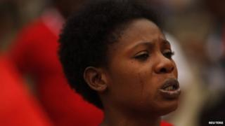 A Nigerian woman cries as she takes part in a protest, called for the release of the abducted secondary school girls from the remote village of Chibok in Nigeria, at La Merced square in Malaga, southern Spain on 13 May 2014
