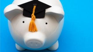 Piggy bank with a mortar board