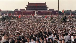 This file photo taken on 2 June 1989 shows hundreds of thousands of Chinese gathering around a 10-metre replica of the Statue of Liberty (C), called the Goddess of Democracy, in Tiananmen Square demanding democracy despite martial law in Beijing