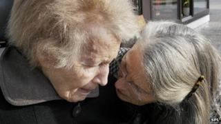 An old woman with Alzheimer's disease and her daughter