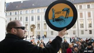 Man holding corruption tour sign